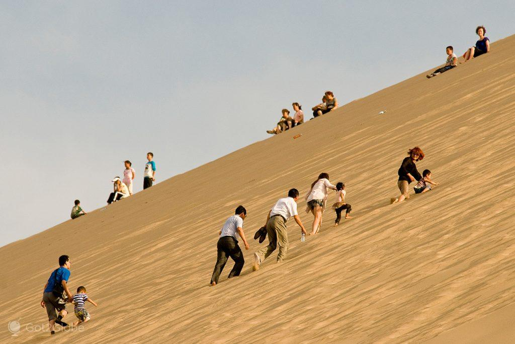 Visitantes chineses de Dunhuang, China